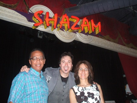 The World's Best Cleaners Pose with the Best Dinner Show Performer in Orlando